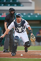 Lakeland Flying Tigers catcher Austin Athmann (19) tracks down a loose ball during a game against the Fort Myers Miracle on August 7, 2018 at Publix Field at Joker Marchant Stadium in Lakeland, Florida.  Fort Myers defeated Lakeland 5-0.  (Mike Janes/Four Seam Images)
