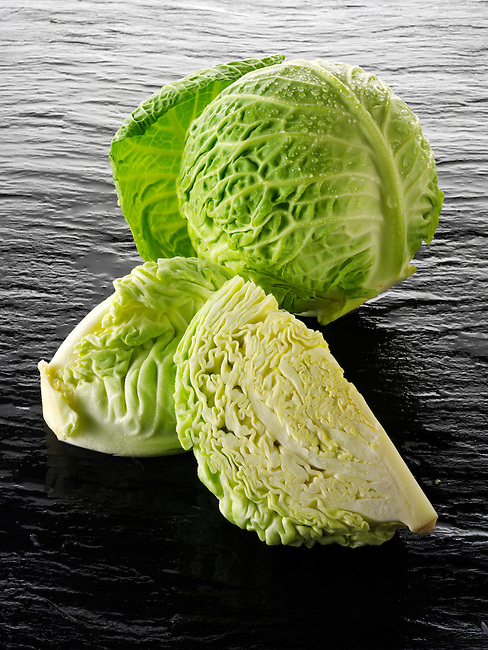 Whole and cut Savoy cabbage