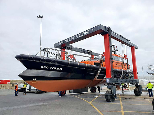 The Dublin Port Pilot boat Tolka in the hoist at the MGM Dun Laoghaire Harbour boatyard