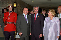 June 25, 2002, Montreal, Quebec, CANADA<br /> <br /> RCMP Corporal Richard Huard (in parade uniform) watch<br /> Gerhard Schroder, Chancellor of the Federal Republic of Germany (L)<br /> Pierre Pettigrew, Minister for International Trade, Canada (M) and<br /> Pauline Marois, Deputy Prime Minister, Minister of State for the Economy and Finance, Quebec (R)<br /> ,arrives at the Conference of Montreal, opening lunch,June 25, 2002 in Montreal, CANADA<br /> <br /> Mandatory credit : Photo by Pierre Roussel - Images Distribution<br /> (c) : 2002,Pierre Roussel