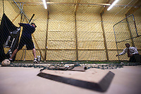Brandon Nimmo, left, eyes a slow pitch from his father, Ron, inside the family's batting cage on Tuesday, June 21, 2011, in Cheyenne, Wyo. (Photo by James Brosher)