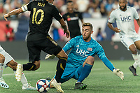 FOXBOROUGH, MA - AUGUST 4: Matt Turner #30 of New England Revolution close save during a game between Los Angeles FC and New England Revolution at Gillette Stadium on August 3, 2019 in Foxborough, Massachusetts.