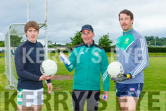Enda Walsh has the sanitiser on hand for cleaning footballs during training with Danny Sheehan and Padraig Lucey