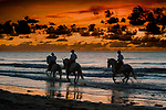 Bahia, Brazil<br /> Regally bred Lusitano horses and their riders gambol in the waves.<br /> <br /> Canon EOS-1Ds Mark II, EF70-200mm f/2.8 lens, f/2.8 for 1/100 second, ISO 400