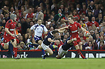 Wales fullback Liam Williams looks inside to Jonathan Davies for support as Scottish pair Duncan Weir and Matt Scott close in.<br /> RBS 6 Nations 2014<br /> Wales v Scotland<br /> Millennium Stadium<br /> <br /> 15.03.14<br /> <br /> ©Steve Pope-SPORTINGWALES