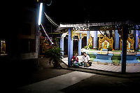 Supporters of the Buddhist nationalist 969 Movement watch a sermon on a projector outside an already full monastery by their spiritual leader U Wirathu, in Mandalay. U Wirathu is an abbot in the New Maesoeyin Monastery where he leads about 60 monks and has influence over more than 2,500 residing there. He travels the country giving sermons to religious and laypeople encouraging Buddhists to shun Muslim business and communities. /Felix Features