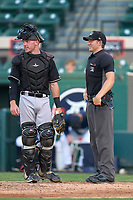 Jupiter Hammerheads catcher Keegan Fish (1) talks with umpire Malcolm Smith during a game against the Lakeland Flying Tigers on July 30, 2021 at Joker Marchant Stadium in Lakeland, Florida.  (Mike Janes/Four Seam Images)