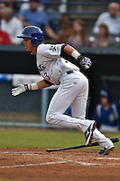 Asheville Tourists designated hitter Max White #13 runs to first during a game against the Greenville Drive at McCormick Field June 24, 2014 in Asheville, North Carolina. The Tourists defeated the Drive 5-4. (Tony Farlow/Four Seam Images)