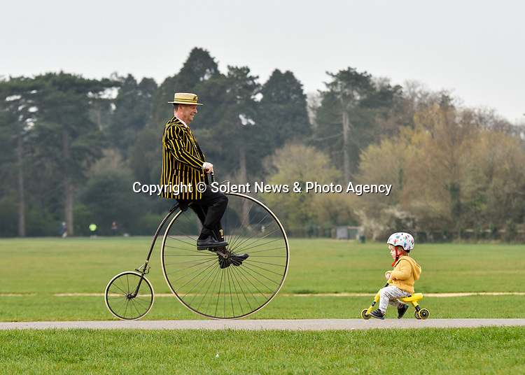 Pictured: Stuart Mason-Elliott, also known as Mr Samuel Pickwick as President of the oldest cycling club in the world The Pickwick Bicycle Club, rides his original 1872 Coventry Machinist Company penny farthing wearing the traditional club uniform alongside Arthur Naish (2) on his tricycle at Southampton Common in Southampton, Hants.<br />  <br /> Stuart rides a 22 kilogram, iron frame penny farthing which is believed to be one of the first bicycles ever made. The wheel diameter is 48 inches, with each bicycle being specially tailored to the leg length of the rider.<br />  <br /> Stuart was elected president of The Pickwick Bicycle Club, formed in 1870  for the second consecutive year, due to Covid-19 restrictions on club activities. Members wear the traditional club uniform of a yellow and black striped blazer, waistcoat with a straw boater hat and are also assigned a sobriquet of a character from The Pickwick Papers, which they represent. <br /> <br /> © Jordan Pettitt/Solent News & Photo Agency<br /> UK +44 (0) 2380 458800