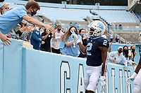 CHAPEL HILL, NC - OCTOBER 10: Dyami Brown #2 of North Carolina celebrates his touchdown with fans in the student section during a game between Virginia Tech and North Carolina at Kenan Memorial Stadium on October 10, 2020 in Chapel Hill, North Carolina.