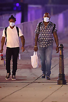 WASHINGTON, D.C. - SEPTEMBER 12: Ozzie Albies and Marcell Ozuna of Major League Baseball's Atlanta Braves, seen leaving Nationals Park after their win against the Washington Nationals during the Covid-19 pandemic-shortened season in Washington, D.C. on September 12, 2020. Credit: mpi34/MediaPunch