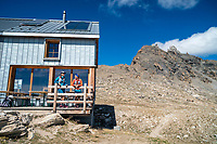 Runners stopped at the Cabane des Becs de Bosson while running the Via Valais, a multi-day trail running tour connecting Verbier with Zermatt, Switzerland.