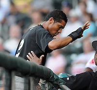Infielder Luis Nieves (2) of the Savannah Sand Gnats is congratulated after scoring a run in Game 1 of the South Atlantic League Southern Division Championship against the Greenville Drive on Sept. 8, 2010, at Fluor Field at the West End in Greenville, S.C. Photo by: Tom Priddy/Four Seam Images