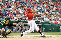 Texas Rangers third baseman Adrian Beltre (29) swings against the Oakland Athetics in American League baseball on May 11, 2011 at the Rangers Ballpark in  Arlington, Texas. (Photo by Andrew Woolley / Four Seam Images)