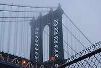 THIS IMAGE IS AVAILABLE EXCLUSIVELY FROM GETTY IMAGES.....PLEASE SEARCH FOR IMAGE # 77184630 ON WWW.GETTYIMAGES.COM.....Manhattan Bridge on a Foggy Afternoon, Upward View, New York City, New York State, USA