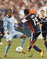 Sporting Kansas City forward Teal Bunbury (9) attempts to control the ball. In a Major League Soccer (MLS) match, Sporting Kansas City defeated the New England Revolution, 1-0, at Gillette Stadium on August 4, 2012.