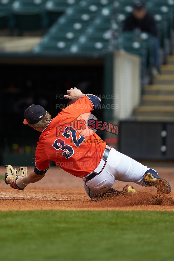 Nate Eikhoff (32) of the Virginia Cavaliers catches a fly ball against the Duke Blue Devils in Game Seven of the 2017 ACC Baseball Championship at Louisville Slugger Field on May 25, 2017 in Louisville, Kentucky. The Blue Devils defeated the Cavaliers 4-3. (Brian Westerholt/Four Seam Images)