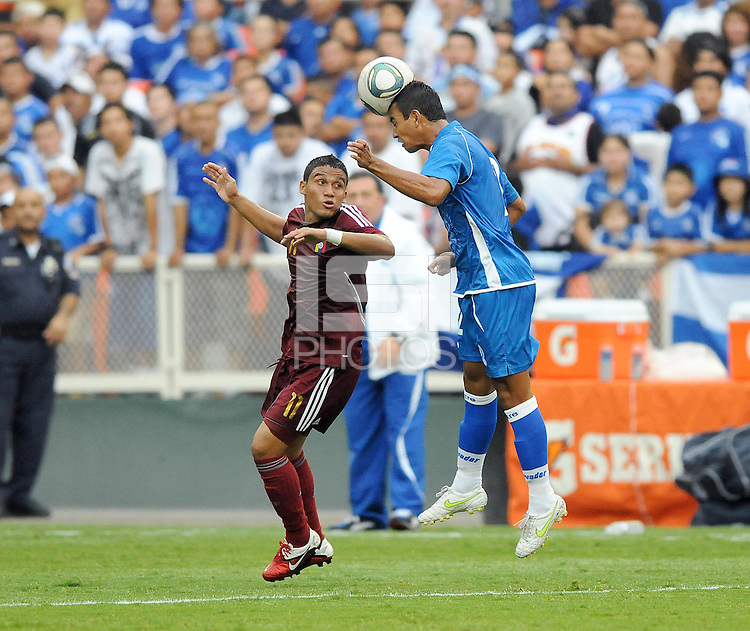 El Salvador defender Xavier Garcia (2) heads the ball against Venezuela midfielder Jesus Lugo (11). El Salvador National Team defeated Venezuela 3-2 in an international friendly at RFK Stadium, Sunday August 7, 2011.