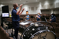 Nathan Andrews, band teacher, directs, Monday, October 5, 2020 at Clinton Junior High School in Clinton. Check out nwaonline.com/2010010Daily/ for today's photo gallery. <br /> (NWA Democrat-Gazette/Charlie Kaijo)