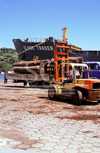 Brazil. Timber from the Amazon being loaded on to a ship 'Globe Trader' for export.