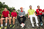 Tennis Legend Boris Becker (center, orange cap), Hong Kong Tennis Association Director Michael walker (left, red shirt) and Mission Hills vice-chairman Tenniel Chu (right, yellow shirt) observe junior tennis players play at Mission Hills Resort on 19 March 2016, in Shenzhen, China. Photo by Lucas Schifres / Power Sport Images