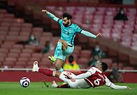 April 3rd 2021; Emriates Stadium, London, England;  Liverpools Mohamed Salah skips over Arsenals Gabriel Magalhaes during the Premier League match between Arsenal and Liverpool at the Emirates Stadium in London