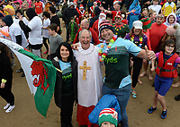 L-R Michelle Evans-Fecci, Great British Bakeoff contestant) with Martyn Williams NYDSwim chairman and Ian Gough Welsh rugby player join hundreds of people in fancy dress have taken part in this year's new year's day swim in Saundersfoot, Wales, UK. Wednesday 01 January 2010
