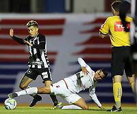 26th August 2020; Estadio Vila Capanema, Curitiba, Brazil; Copa Do Brasil, Parana Clube versus Botafogo; Higor Metitão of Parana Clube dives in to tackle Bruno Nazário of Botafogo