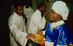 """The Celestial Church of Christ. Sugar and honey are offered to worshipers as an example of the 'sweetness of life"""". London 1990s. This west African church was founded by S B J Oshoffa Mainly attended by Yoruba people from western Nigeria the church  flourishes with offshoots in London Paris and New York This  photograph is taken from the book The Storm is Passing Over"""""""