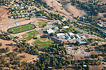 Over Amador County-aerials of Sutter Creek--Amador High School and Sutter Creek Cemetery