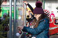 "Pictured: Local people help decorate the Christmas tree in Neath, south Wales, UK. Saturday 03 December 2016<br /> Re: Residents are making their own decorations for Neath's Christmas tree this year after complaints about the town's festive decorations.<br /> Neath resident Darren Bromham-Nichols is calling on others to create their own decorations for the tree near the town centre, which has been described as ""bare with lots of dead wood."", although the town council has said it has received no complaints.<br /> He hopes this will make Neath Town Council, who have funded the Christmas decorations for the town, take notice and help to decorate the tree."