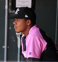 Erie Seawolves infielder Francisco Martinez #20 in the dugout during a game against the Reading Phillies at Jerry Uht Park on May 29, 2011 in Erie, Pennsylvania.  Erie defeated Reading 6-5 in ten innings.  Photo By Mike Janes/Four Seam Images