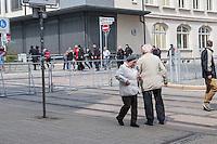 """Ca. 1000 Nazis aus ganz Deutschland marschierten am Sonntag den 1. Mai 2016 im Saeschsichen Plauen auf. Die Naziorganisation 3.Weg hatte den Marsch angemeldet. Etliche Nazis waren dabei vermummt und zeigten auch den Hitlergruss, die Polizei schritt jedoch nicht ein.<br /> Nach der Haelfte der Marschroute beendeten die Nazis ihre Demonstration, da die Polizei die Marschroute verkuerzen wollte. Sie forderten die Polizei auf den Weg freizugeben. Danach griffen Aufmarschteilnehmer die Polizei an, die daraufhin Wasserwerfer, Pfefferspray, Traenengas und Schlagstoecke einsetzte. Mehrere Gruppen Nazis zogen danach durch Plauen und jagten Menschen.<br /> Nach einer Stunde bekamen die Nazis einen erneuten Aufmarsch von der Polizei genehmigt und zogen zurueck zum Bahnhof.<br /> Im Bild: Eine der Nazi-Gruppen, die durch Plauen zogen und ungehindert Jagd auf vermeindliche Gegner und Journalisten machen konnten.<br /> Links neben dem Strassenschild: Matthias Fischer aus Fuerth. Fischer hat massgeblich die verbotene Naziorganisation """"Freies Netz Sued"""" geleitet. Er ist mit am Aufbau vom """"3. Weg"""" in Brandenburg beteiligt und ist beteiligt am Naziversandhandel """"Final Resistance"""".<br /> 1.5.2016, Plauen<br /> Copyright: Christian-Ditsch.de<br /> [Inhaltsveraendernde Manipulation des Fotos nur nach ausdruecklicher Genehmigung des Fotografen. Vereinbarungen ueber Abtretung von Persoenlichkeitsrechten/Model Release der abgebildeten Person/Personen liegen nicht vor. NO MODEL RELEASE! Nur fuer Redaktionelle Zwecke. Don't publish without copyright Christian-Ditsch.de, Veroeffentlichung nur mit Fotografennennung, sowie gegen Honorar, MwSt. und Beleg. Konto: I N G - D i B a, IBAN DE58500105175400192269, BIC INGDDEFFXXX, Kontakt: post@christian-ditsch.de<br /> Bei der Bearbeitung der Dateiinformationen darf die Urheberkennzeichnung in den EXIF- und  IPTC-Daten nicht entfernt werden, diese sind in digitalen Medien nach §95c UrhG rechtlich geschuetzt. Der Urhebervermerk wird gemaess §13 UrhG ve"""