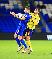 28th September 2021; Cardiff City Stadium, Cardiff, Wales;  EFL Championship football, Cardiff versus West Bromwich Albion; James Collins of Cardiff City controls the ball as he is pulled back by Jake Livermore of West Bromwich Albion