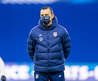 LE HAVRE, FRANCE - APRIL 13: Vlatko Andonovski of the USWNT watches his team before a game between France and USWNT at Stade Oceane on April 13, 2021 in Le Havre, France.