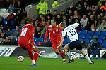 International Friendly match between Wales and Scotland at the new Cardiff City Stadium : Wales' Captain Ashleigh Williams runs the ball past Scotlands' Barry Robson.