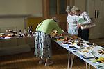 Petersham village fete Produce and Flower Show Richmond, Surrey UK. Middle class England senior women checking out cake baking entries. 2010s 2011