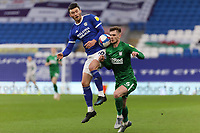 (L-R) Kieffer Moore of Cardiff City clashes against Liam Lindsay of Preston North End during the Sky Bet Championship match between Cardiff City and Preston North End at the Cardiff City Stadium, Cardiff, Wales, UK. Saturday 20 February 2021