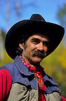 Portrait of a smiling cowboy with a black hat in Colorado, USA