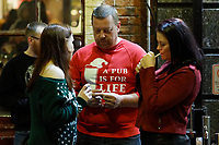 "Pictured: A Christmas reveller with a ""Pub is for life not just for Christmas t-shirt"" in Wind Street, Swansea, Wales, UK. Friday 20 December 2019<br /> Re: Black Eye Friday (also known as Black Friday, Mad Friday, Frantic Friday) the last Friday before Christmas, in Swansea, Wales, UK."