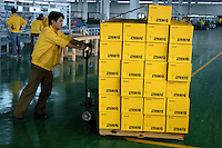 Completed products being shifted on trolley in a privately owned metal works factory, producing parts for major foreign companies including Fuji Xerox, Panasonic, Black & Decker and DeWalt, both for Chinese market and for export (including UK, US and Japan).