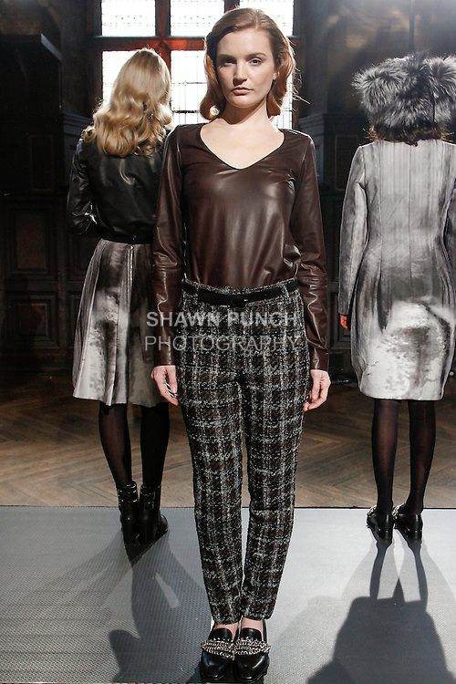 Model poses in an outfit from the Heather Lawton Fall/Winter 2014 collection by Heather Lawton, at her fashion presentation at the High Line Hotel, during New York Fashion Week Fall 2014, February 5, 2013.