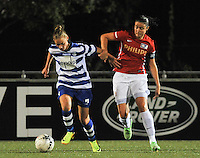 20130906 - OOSTAKKER , BELGIUM : Gent's Margaux Van Ackere (left)  pictured with PSV captain Manon Van den Boogaard (right) during the female soccer match between AA Gent Ladies  and PSV / FC Eindhoven Dames , of the third matchday in the BENELEAGUE competition. Friday 06 th September 2013. PHOTO DAVID CATRY