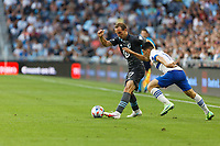 SAINT PAUL, MN - JULY 3: Chase Gasper #77 of Minnesota United FC and Cristian Espinoza #10 of the San Jose Earthquakes during a game between San Jose Earthquakes and Minnesota United FC at Allianz Field on July 3, 2021 in Saint Paul, Minnesota.