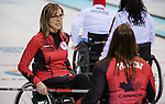 Sochi, RUSSIA - Mar 10 2014 -  Sonja Gaudet discusses strategy with Ina Forrest during Canada vs Norway in Wheelchair Curling round robin play at the 2014 Paralympic Winter Games in Sochi, Russia.  (Photo: Matthew Murnaghan/Canadian Paralympic Committee)