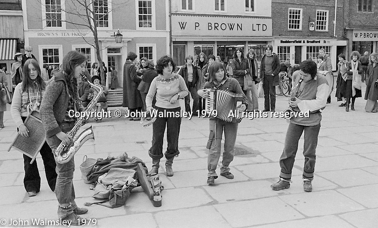 The York Street Band playing in York, March 1979.  Sarah Kemp on washboard, Dena Attar on saxophone, then the three members of the YSB: Sarha Moore (tambourine), Anthea Gomez (accordian) and Ros Davies (saxophone).  Sarha Moore and Ros Davies went on to play in The Bollywood Band, and Ros also joined the Grand Union Band, in London.  Anthea Gomez went on to write and play music for the theatre and then BBC Drama before changing direction.