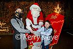 Little Matthew O'Sullivan with his mom Catherine visiting the Santa sleigh at Gallys on Saturday