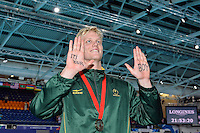 Leith Shankland of RSA displays phrase It's your boy for his family members in the stands with 4x100 meter medley relay bronze medal, Tuesday, July 29, 2014 in Glasgow, United Kingdom. (Mo Khursheed/TFV Media via AP Images)
