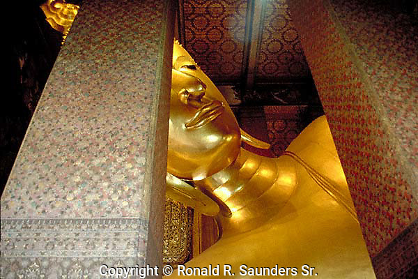 Gold plated giant buddha statue<br /> at Wat Pho (the Temple of the Reclining Buddha), aka: Wat Phra Chetuphon, located behind the splendid Temple of the Emerald Buddha. It's the largest temple in Bangkok and famed for its huge and majestic reclining.