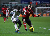 Saturday, 08 February 2014<br /> Pictured L-R:  Nathan Dyer of Swansea attempts to cross the ball, closely marked by Declan John of Cardiff. <br /> Re: Barclay's Premier League, Swansea City FC v Cardiff City at the Liberty Stadium, south Wales, UK.